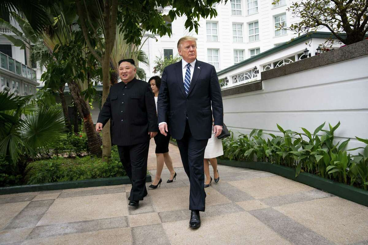 President Donald Trump and Kim Jong Un, the North Korean leader, walk together to a meeting at the Metropole Hotel in Hanoi, Vietnam, Feb. 28. A reader discusses the president's belated trip to Vietnam.