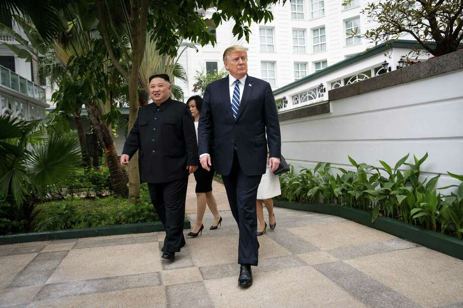 President Donald Trump and Kim Jong Un, the North Korean leader, walk together to a meeting at the Metropole Hotel in Hanoi, Vietnam, Feb. 28. A reader discusses the president's belated trip to Vietnam. Photo: DOUG MILLS /NYT / NYTNS
