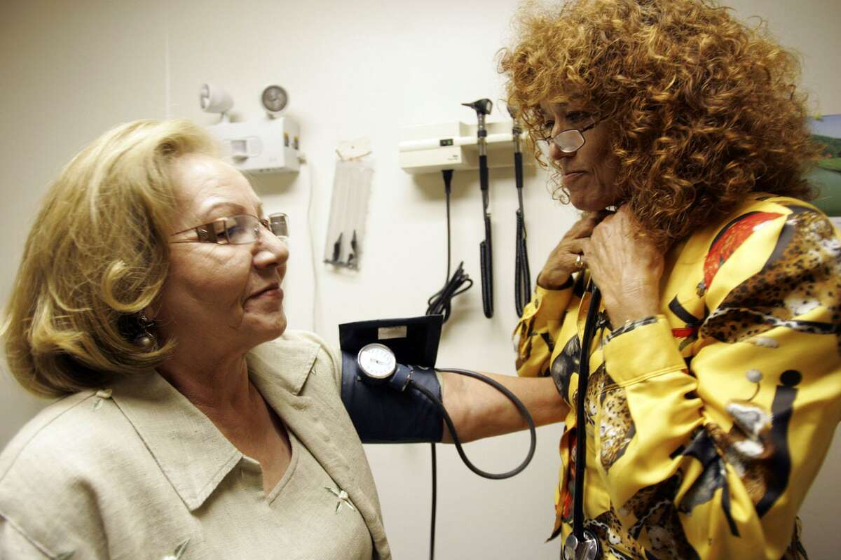 Primary care doctor Linda Villarreal takes a blood pressure test on Maria Herrera, 65, at her office in Edinburg, Texas. A reader says Texas needs more primary care doctors to cater to the state's large population.