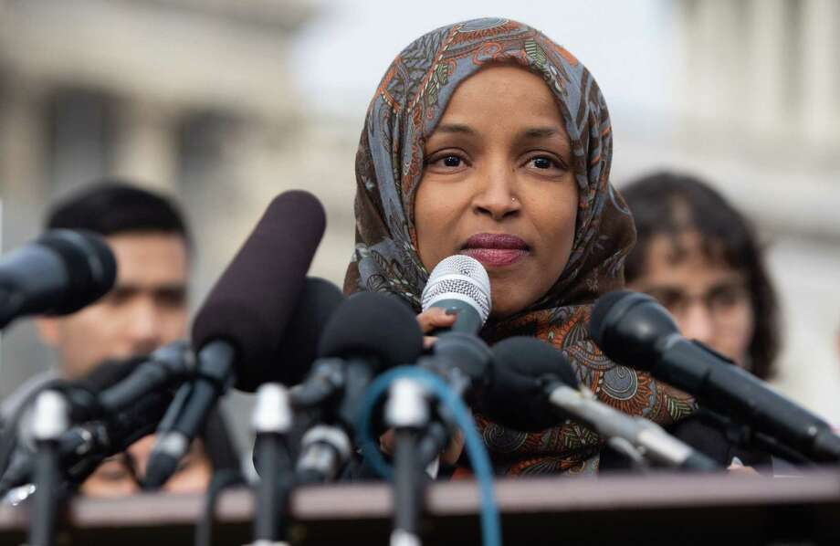 """(FILES) In this file photo taken on February 7, 2019 US Representative Ilhan Omar, Democrat of Minnesota, speaks during a press conference calling on Congress to cut funding for US Immigration and Customs Enforcement (ICE) and to defund border detention facilities, outside the US Capitol in Washington, DC. - The US House will vote as early as March 5, 2019 to condemn anti-Semitism, following another round of controversial comments by a new congresswoman who criticized pro-Israel lawmakers for potential """"allegiance"""" to a foreign country. The resolution is not expected to specifically name Ilhan Omar, one of the first Muslim women ever elected to Congress, but the vote will be a clear reprimand against the freshman from Minnesota -- and the second public admonishment by fellow Democrats that she will have received since coming to Washington. (Photo by SAUL LOEB / AFP)SAUL LOEB/AFP/Getty Images Photo: SAUL LOEB / AFP/Getty Images / AFP or licensors"""