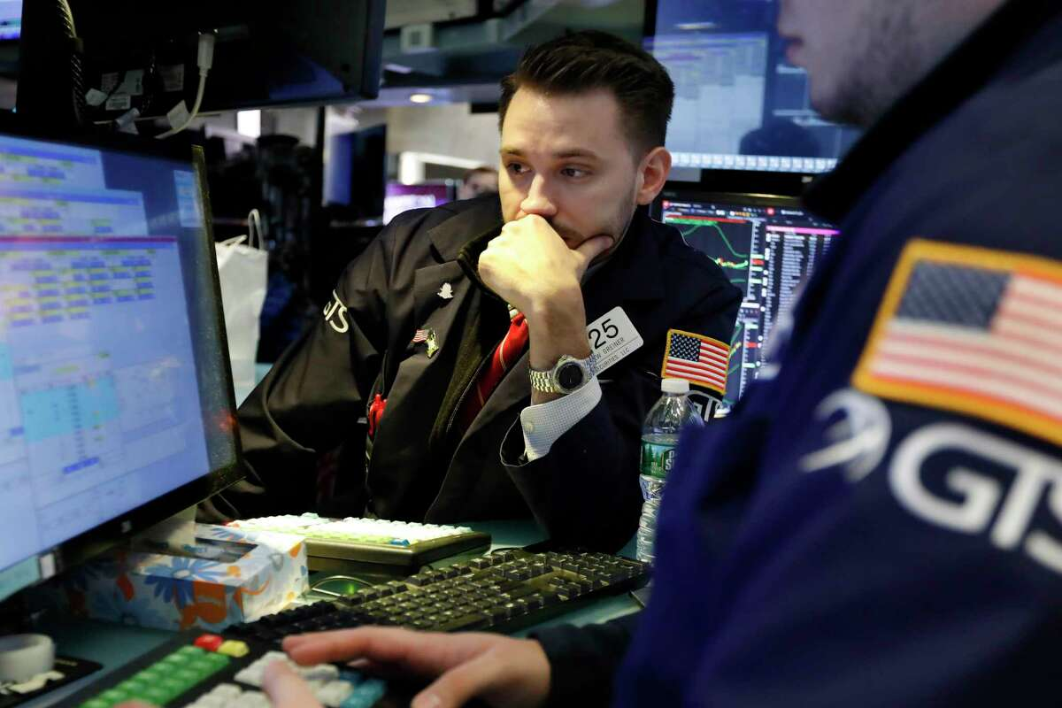 Specialist Matthew Grenier works on the floor of the New York Stock Exchange, Tuesday, March 5, 2019. Stocks are opening slightly lower on Wall Street led by losses in banks and technology companies. (AP Photo/Richard Drew)