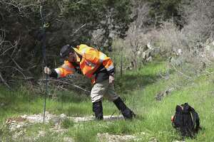 Blair Burton of Texas Search and Rescue, uses a search rod to check a soft ground area as he leads a group of volunteers searching for missing woman Andreen McDonald along Cibolo Creek near Specht Rd, on Tuesday, March 5, 2019.