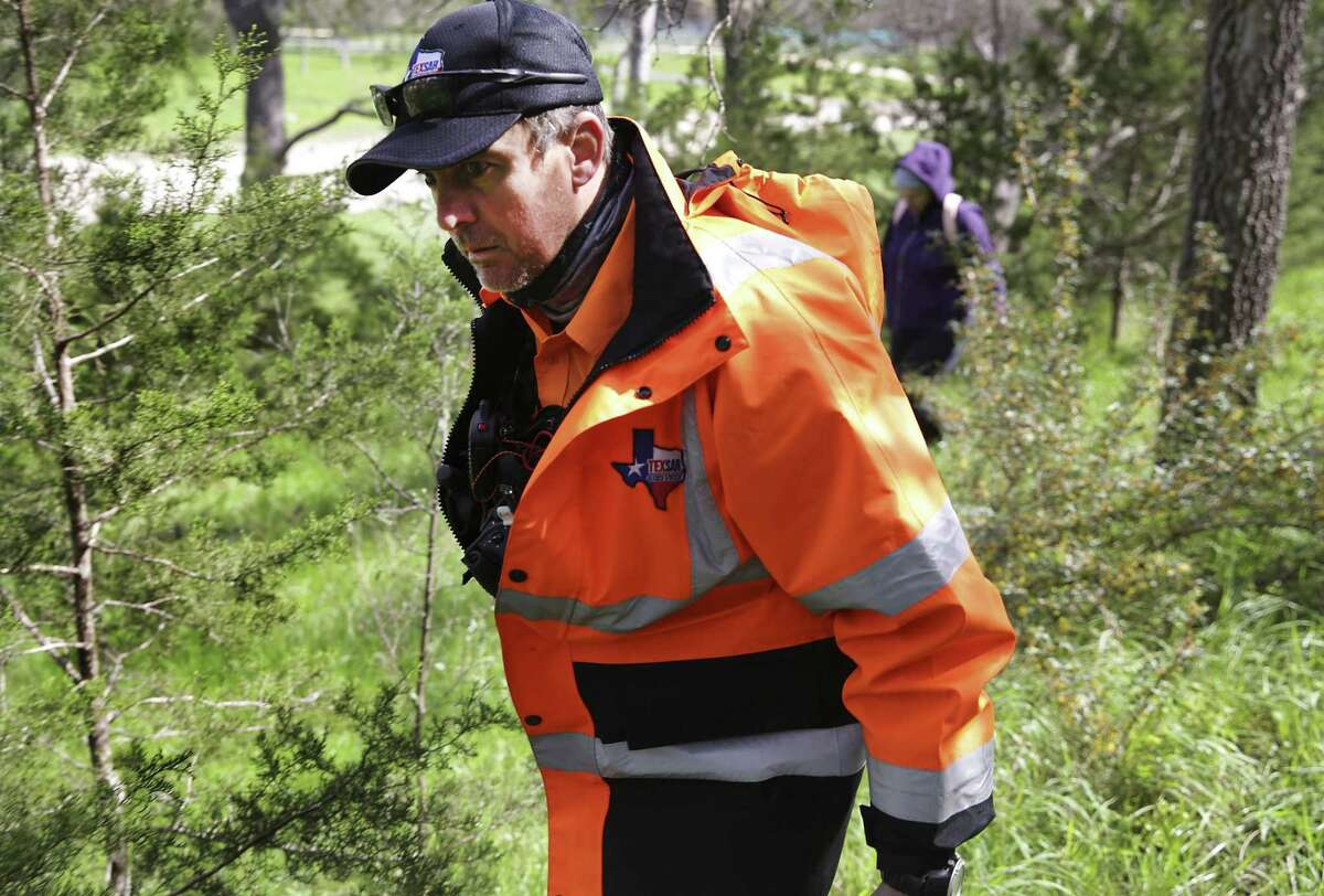 Blair Burton of Texas Search and Rescue, leads a group of volunteers searching for missing woman Andreen McDonald along Cibolo Creek near Specht Rd, on Tuesday, March 5, 2019.