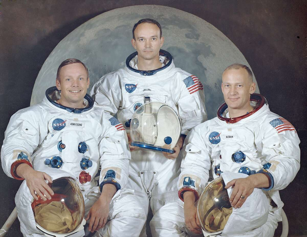 PHOTOS: July 16, 1969: This is the official crew portrait of the Apollo 11 astronauts. Pictured from left to right are: Neil A. Armstrong, Commander; Michael Collins, Module Pilot; Edwin E.