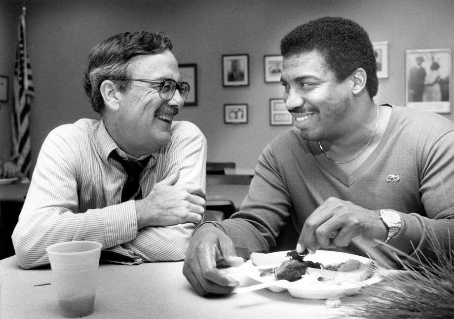 Outgoing Harris County Commissioner Tom Bass is shown Dec. 14, 1984, with incoming commissioner El Franco Lee at a Christmas party held at Adair Park. Photo: Betty Tichich, HC Staff / Houston Chronicle / Houston Chronicle