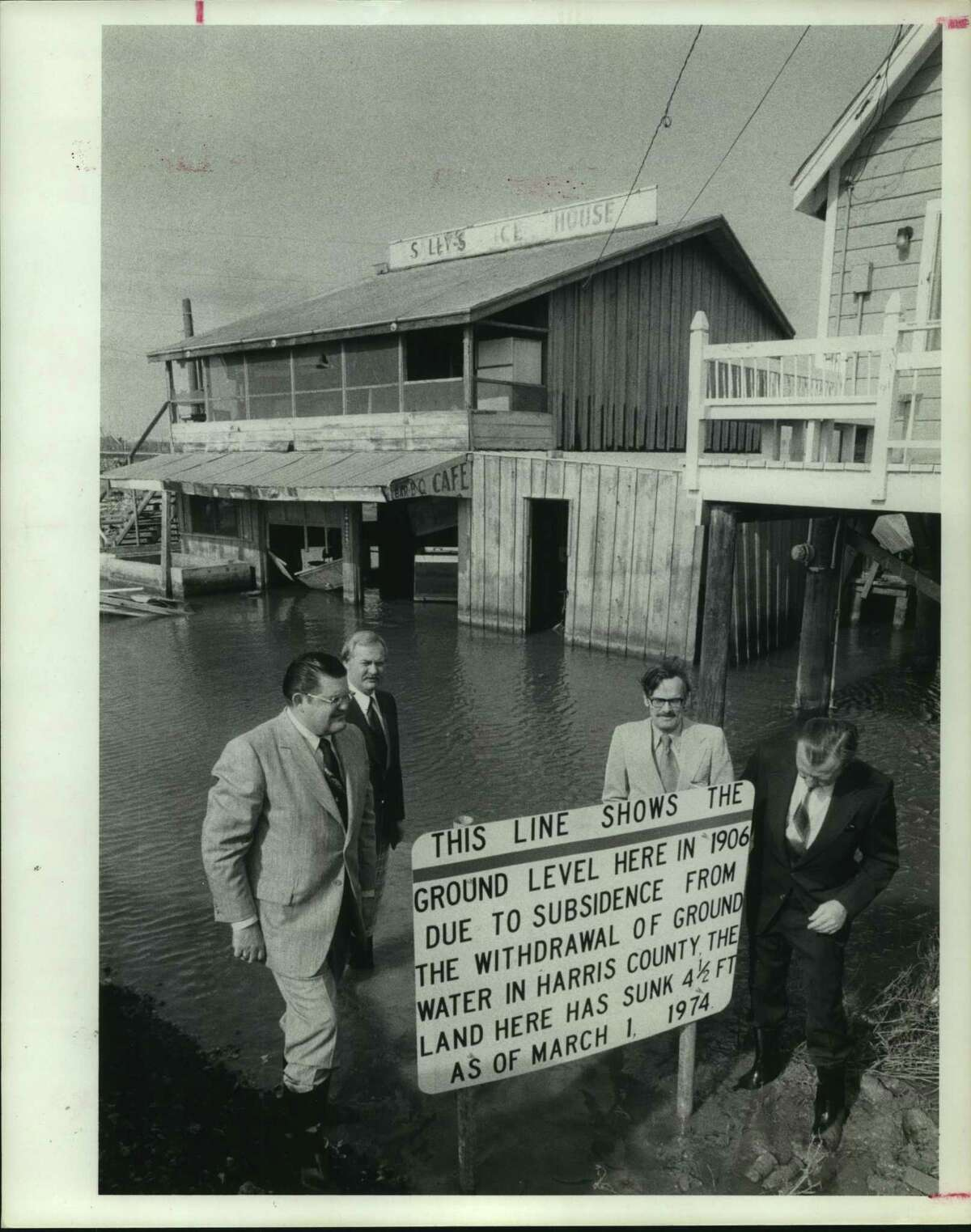 Harris County and Seabrook officials examine the effects of land subsidence outside a Seabrook icehouse in this undated photo. From left, Commissioner Jamie Brady, Seabrook Mayor Larry G. Sullivan, Commissioner Tom Bass and County Judge Bill Elliott. >>>See other Houston-area notable deaths of 2019 ...