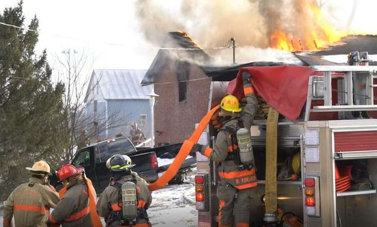 Firefighters arriving on the scene of a blaze in the 4000 block of Culp Lane Tuesday prepare to fight the fire.