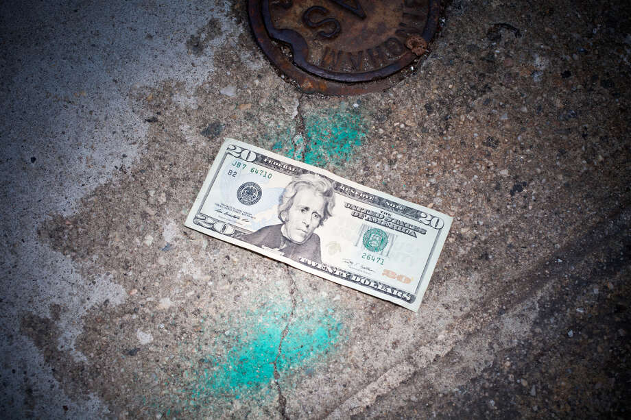 A $20 bill on a street. Photo: William Andrew / Getty Images