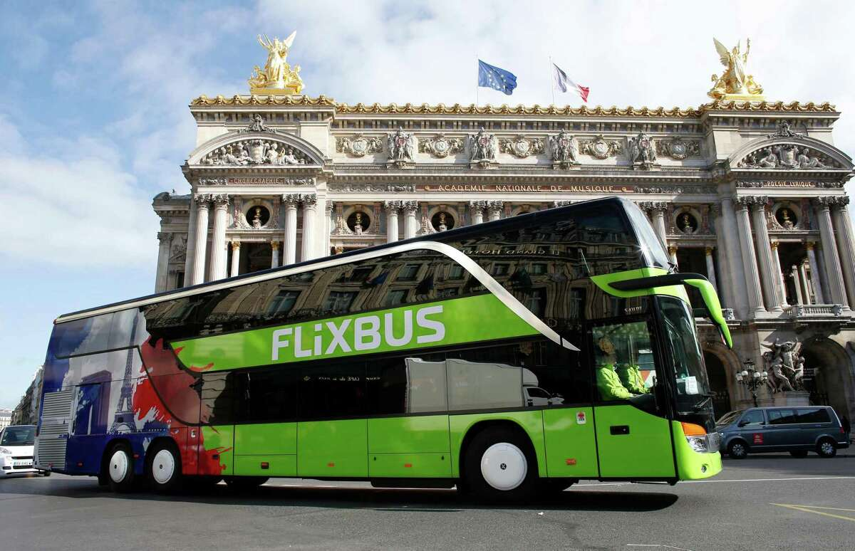 In this file photo taken May 19, 2015, a bus of the German intercity bus service FlixBus drives past the Palais Garnier opera house in Paris.