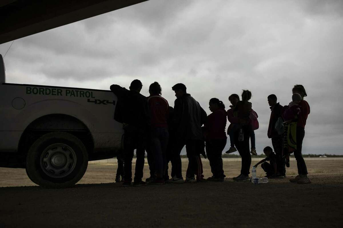 Asylum seekers from Central America are taken into custody by U.S. Border Patrol agents near Granjeno, Texas, after they illegally crossed from Mexico and turned themselves in, Feb. 1, 2019. On Tuesday, the agency is expected to announce a significant expansion of the health care services it provides to migrants. (Tamir Kalifa/The New York Times)