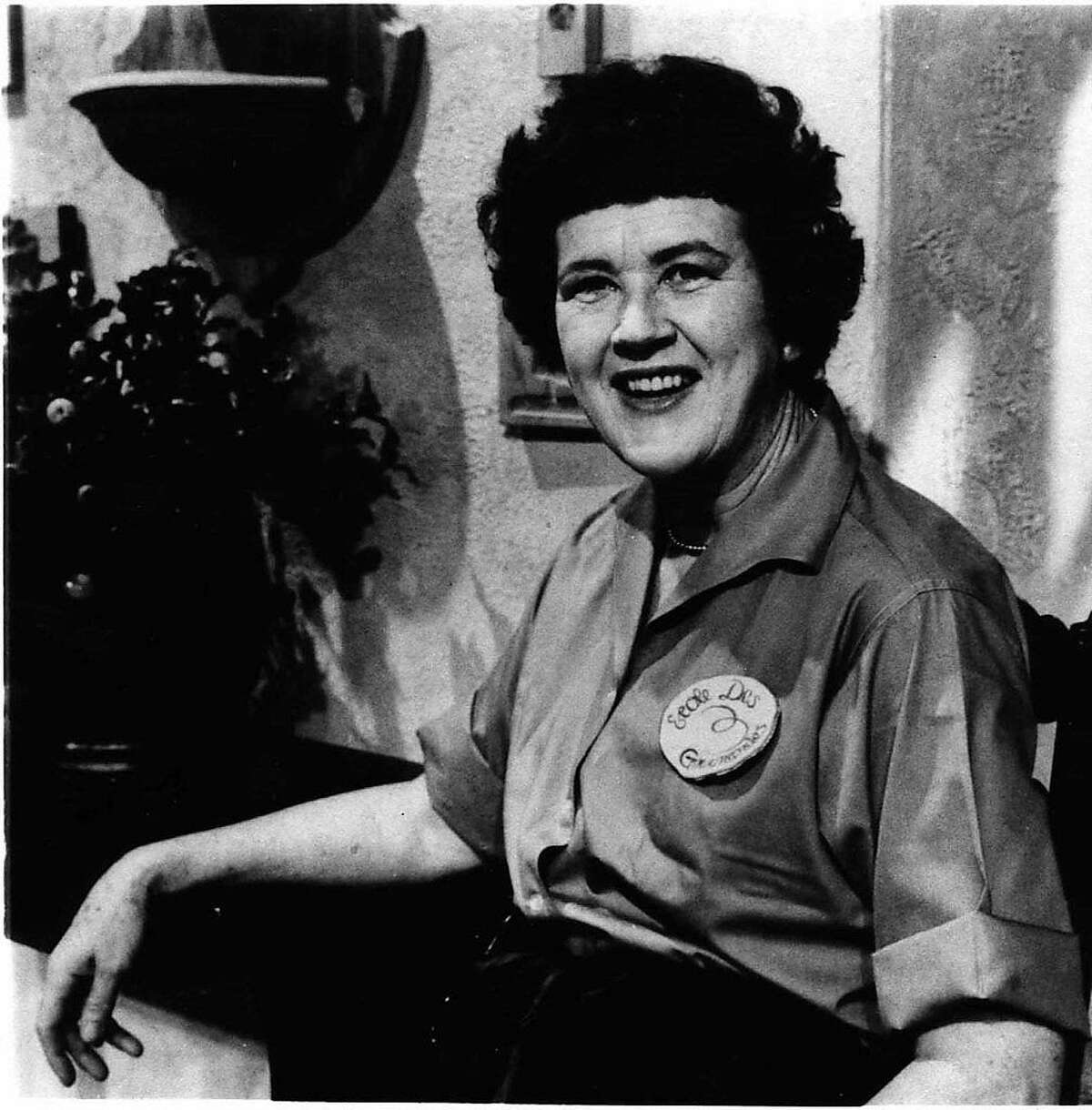"""This 1967 file photo shows Julia Child explaining """"with a little practice"""" you can do everything with the flare of a gourmet. More so than the tools and techniques she popularized, Child's most lasting legacy may be her spirit and sense of humor. That was the conclusion of several chefs and food magazine editors asked to describe Child's memorable contributions to American home cooking as a new movie about her life is about to open. (AP Photo,File)"""