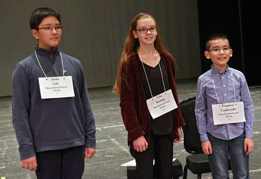 From left, winner seventh-grader Jaeho Lee of the Shenendehowa School District, third place finisher Julia Sealing, an eight-grader from Shenendehowa, and second place finisher fifth-grader Kingston Czajkowski of the Cairo-Durham Central School District smile while their families take photos after the Capital Region Spelling Bee at Proctors on Tuesday, March 5, 2019 in Schenectady, N.Y. He came in second place. Jaeho will advance to the 92nd Scripps National Spelling Bee in Washington D.C. in May. (Lori Van Buren/Times Union)