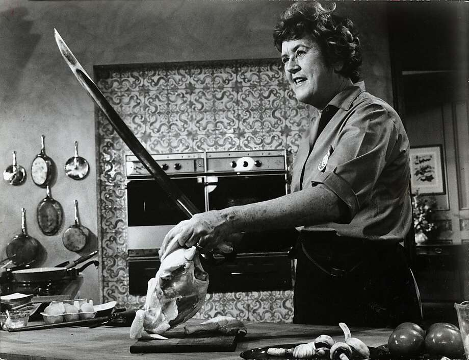 Julia Child approaches cooking in the swashbuckling fashion that has made her the darling of public television. Julia Child cooking expert. Dated Nov. 11, 1971.