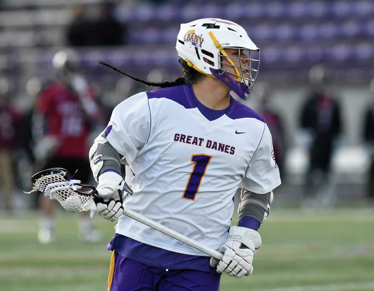 University at Albany's Tehoka Nanticoke (1) moves the ball agianst University of Massachusetts during a home opener NCAA lacrosse game Tuesday March 5, 2019, in Albany, N.Y.