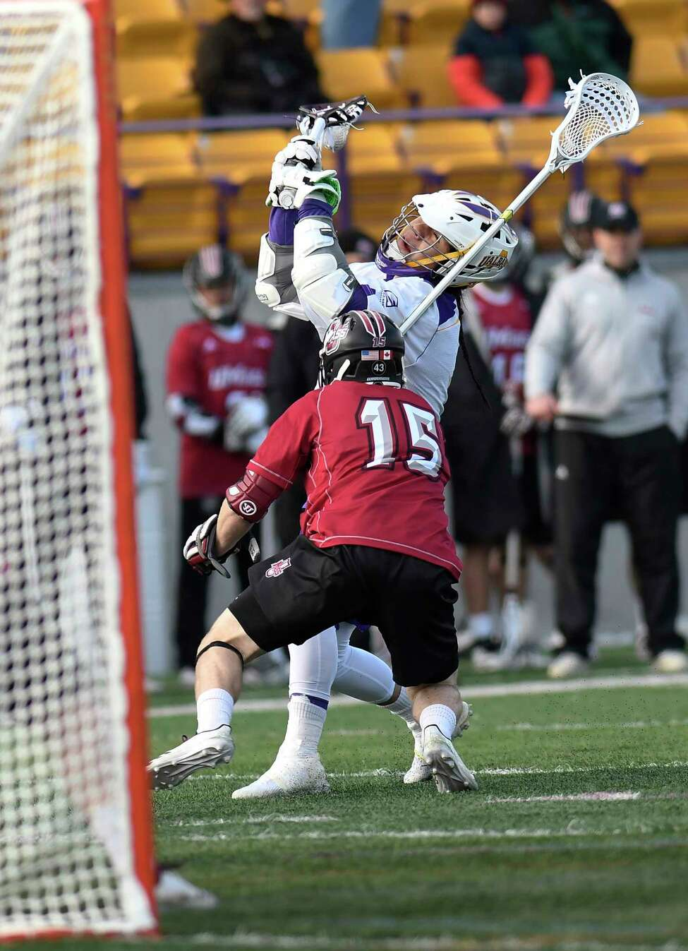 University at Albany's Tehoka Nanticoke ,top right, shoots the ball agianst University of University of Massachusetts' Isaac Paparo (15) during a home opener NCAA lacrosse game Tuesday March 5, 2019, in Albany, N.Y.