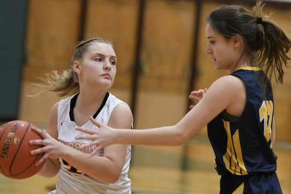 Cambridge's Jalyn Prouty keeps the ball away from Madrid-Waddington's Alexis Sullivan during their state regional match at Shenendehowa High School in Clifton Park, N.Y. on Tuesday, Mar. 5, 2019. (Jenn March, Special to the Times Union)