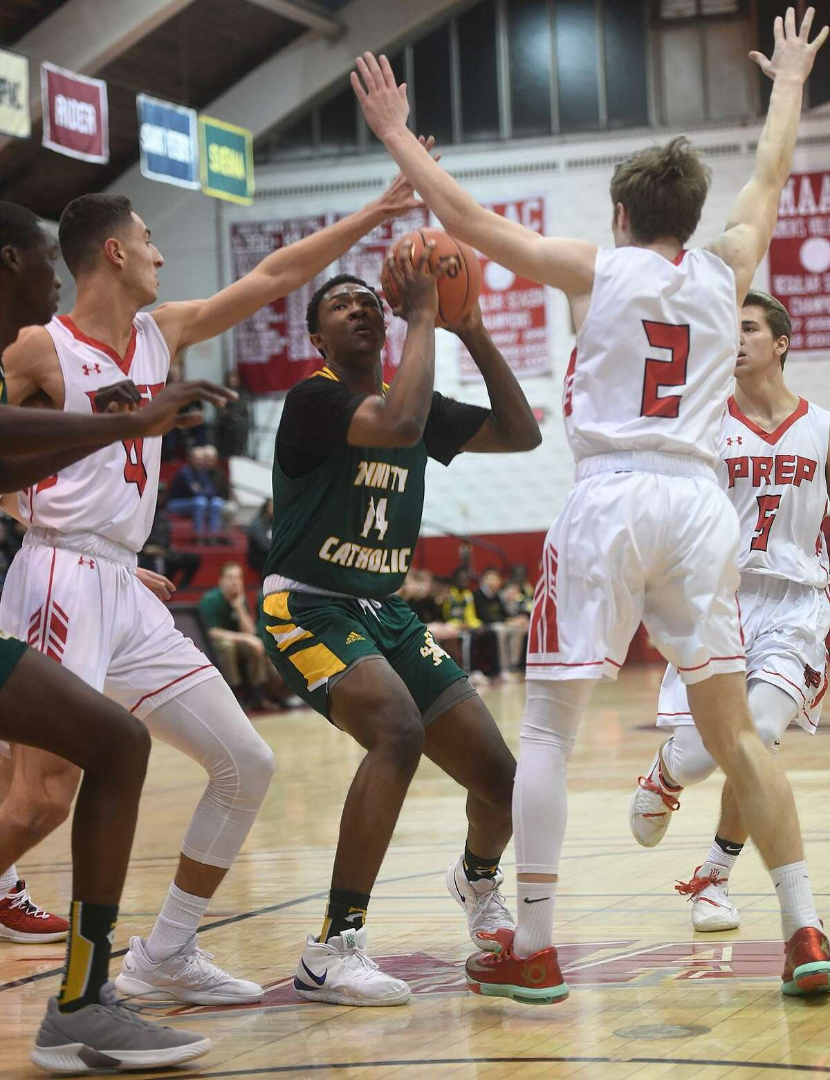Trinity Catholic's Rahsen Fisher looks to score against Fairfield Prep during Tuesday night's Div. I game at Alumni Hall in Fairfield.