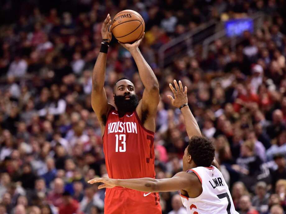 Houston Rockets guard James Harden (13) shoots over Toronto Raptors guard Kyle Lowry (7) during the second half of an NBA basketball game Tuesday, March 5, 2019, in Toronto. (Frank Gunn/The Canadian Press via AP) Photo: Frank Gunn, Associated Press / The Canadian Press