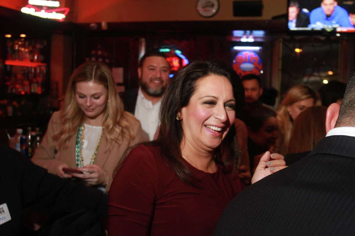 Christina Morales greets supporters at watch party after special election runoff for House District 145.