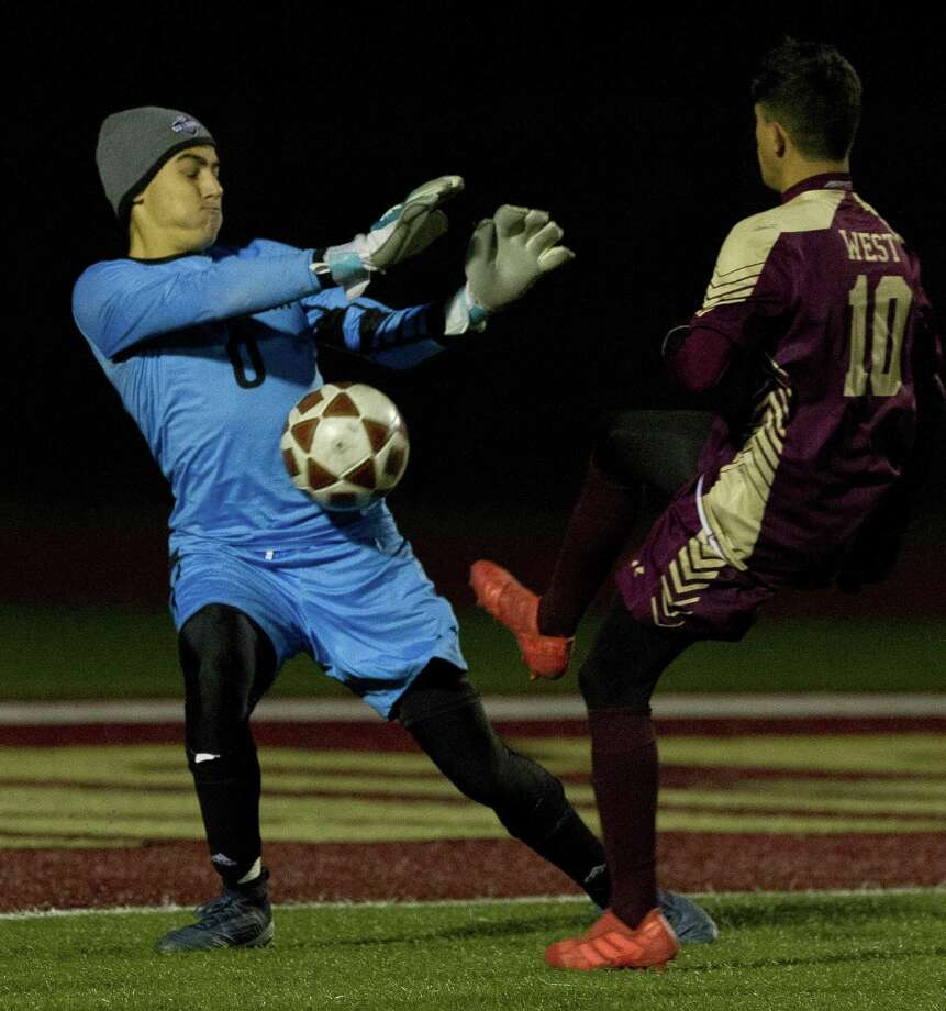 Magnolia goalie Emilio Velazquez (0) stops a shot by Jeremias Gonzalez (10) of Magnolia West during the first period of a District 19-5A high school soccer match at Magnolia West High School, Tuesday, March 5, 2019, in Magnolia. Photo: Jason Fochtman, Houston Chronicle / Staff Photographer / © 2019 Houston Chronicle