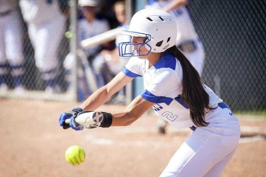 In this file photo, New Caney's Teralyn Guardado (2) bunts the ball during the softball game against Humble on Monday, March 12, 2018, in New Caney. Photo: Michael Minasi, Staff Photographer / Houston Chronicle / © 2018 Houston Chronicle