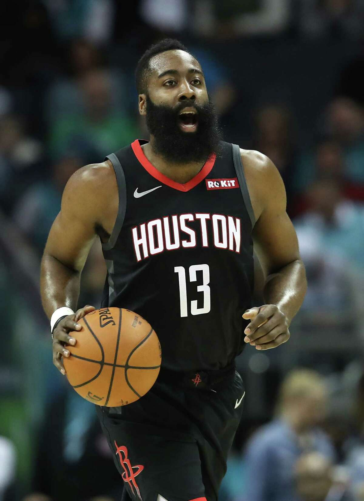 CHARLOTTE, NORTH CAROLINA - FEBRUARY 27: James Harden #13 of the Houston Rockets brings the ball up the court against the Charlotte Hornets during their game at Spectrum Center on February 27, 2019 in Charlotte, North Carolina. NOTE TO USER: User expressly acknowledges and agrees that, by downloading and or using this photograph, User is consenting to the terms and conditions of the Getty Images License Agreement. (Photo by Streeter Lecka/Getty Images)