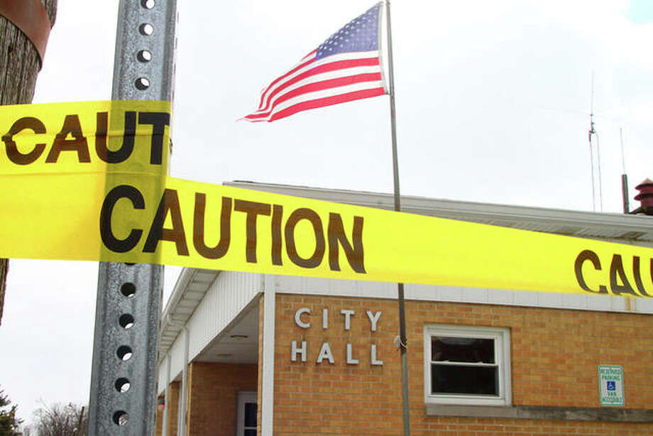 Caution tape blocks access to Winchester City Hall on Tuesday afternoon as Illinois State Police investigated the stabbing of a man in downtown Winchester. Photo: Rosalind Essig | Journal-Courier