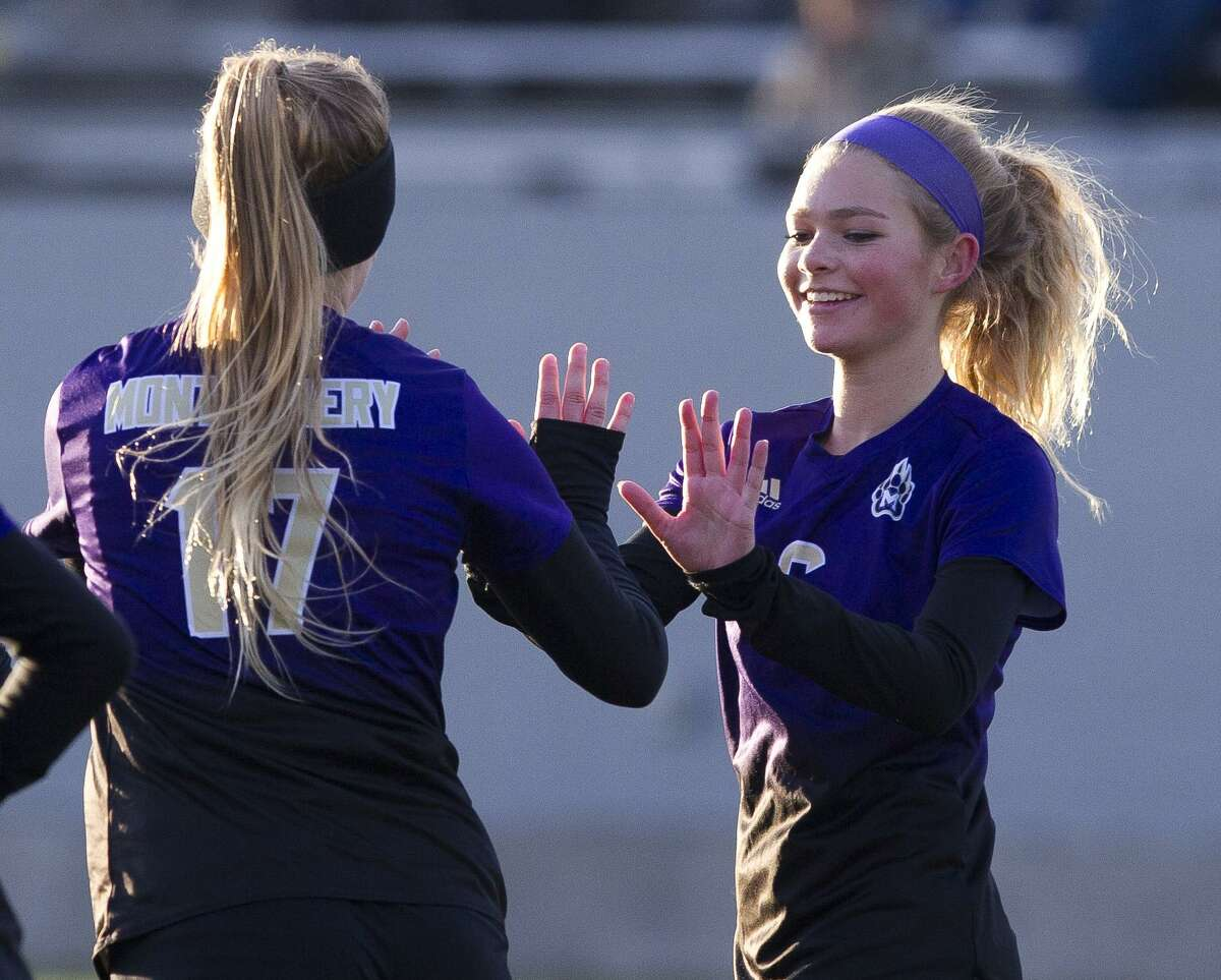 Montgomery midfielder Mable Pruter (6) reacts after a goal by Kayla Art (17) during the first period of a District 20-5A high school soccer match at Montgomey High School, Tuesday, March 5, 2019, in Montgomery.