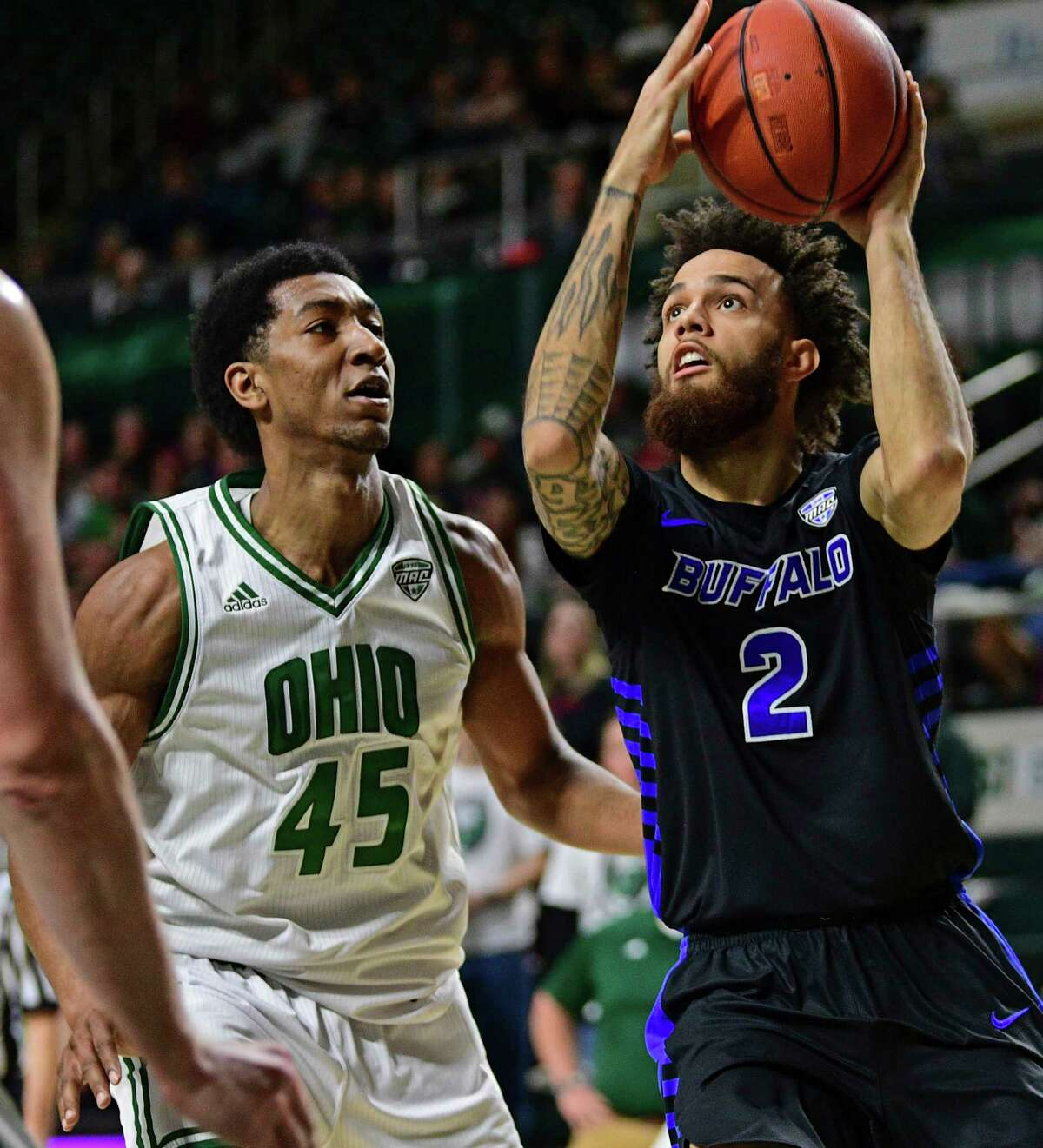 Buffalo guard Jeremy Harris shoots next to Ohio forward Doug Taylor during the second half of an NCAA college basketball game Tuesday, March 5, 2019, in Athens, Ohio. Buffalo won 82-79. (AP Photo/David Dermer)