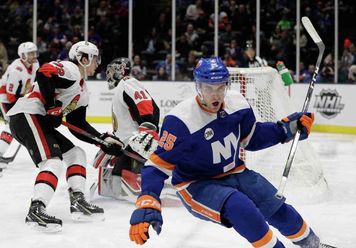 New York Islanders defenseman Devon Toews (25) reacts after scoring a goal on Ottawa Senators goaltender Craig Anderson (41) during the second period of an NHL hockey game Tuesday, March 5, 2019, in Uniondale, N.Y. (AP Photo/Kathy Willens)