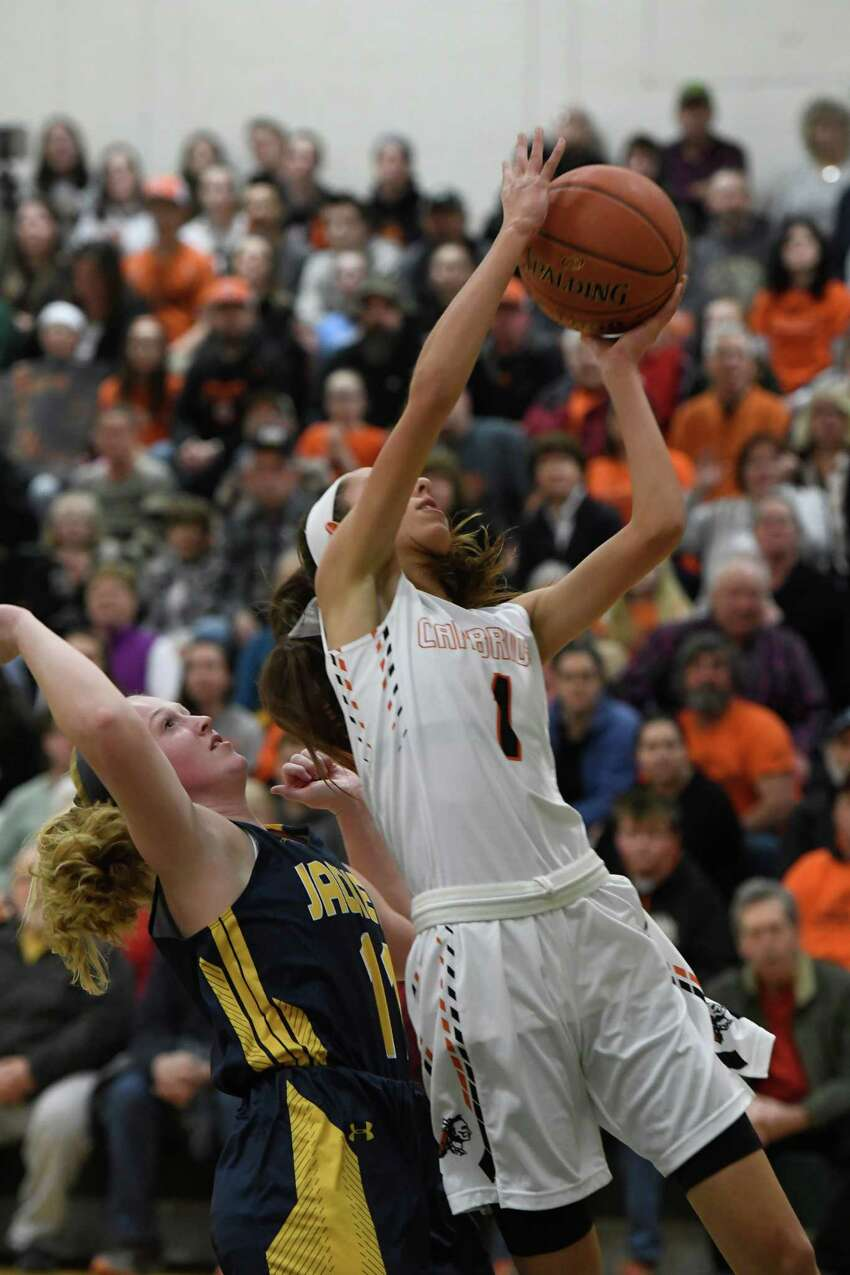 Cambridge's Lilly Phillips jumps past Madrid-Waddington's Kellsie Tiernan for a basket during their state regional match at Shenendehowa High School in Clifton Park, N.Y. on Tuesday, Mar. 5, 2019. (Jenn March, Special to the Times Union)