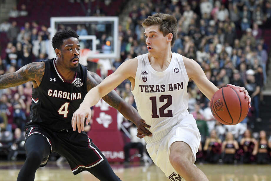Texas A&M's Chris Collins (12) moves the ball past South Carolina's Tre Campbell (4) in the first half March 5, 2019 at Reed Arena in College Station. Photo: Laura McKenzie, Bryan Eagle