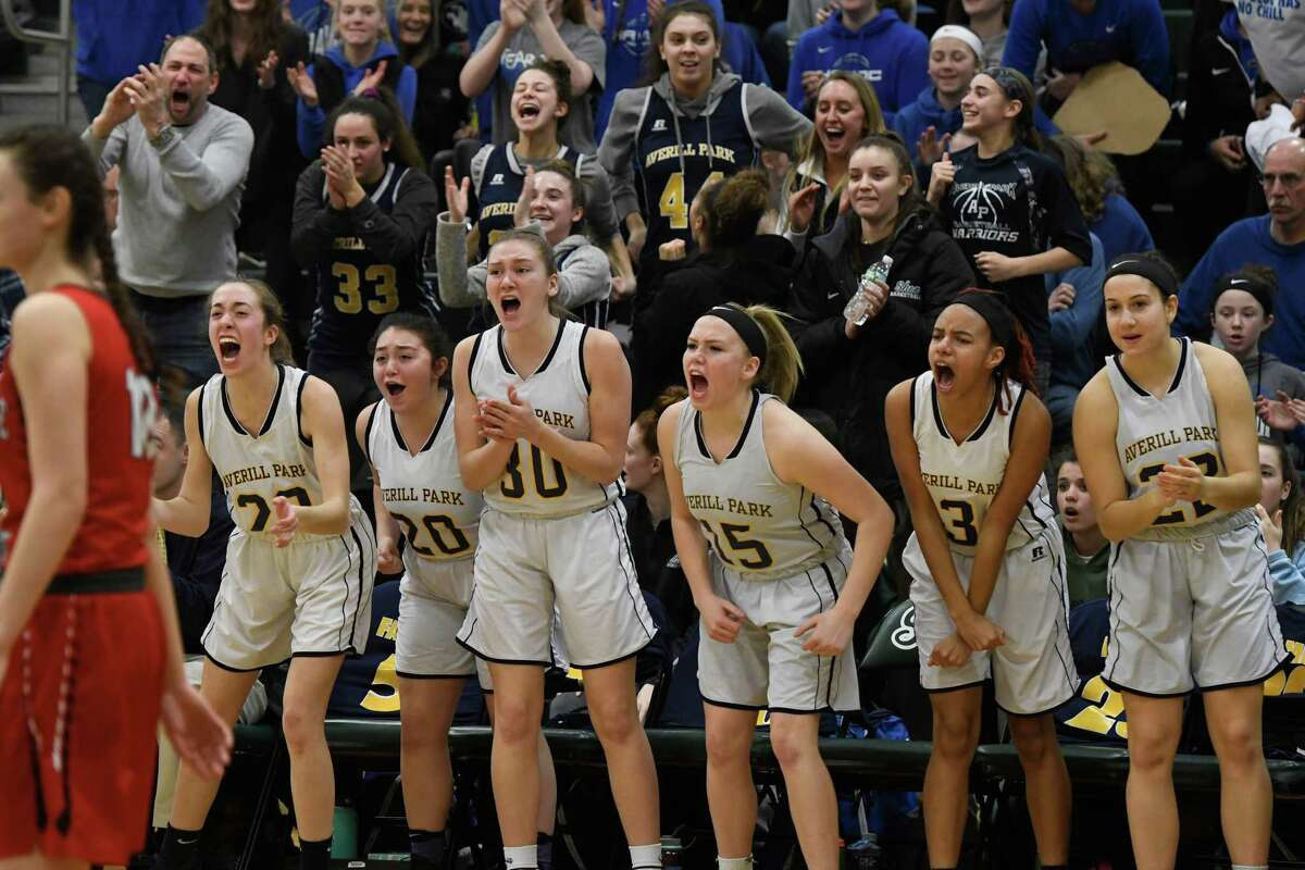 Averill Park girls basketball players cheer after their team scored a basket during their Class A state regional match at Shenendehowa High School in Clifton Park, N.Y. on Tuesday, Mar. 5, 2019. (Jenn March, Special to the Times Union)