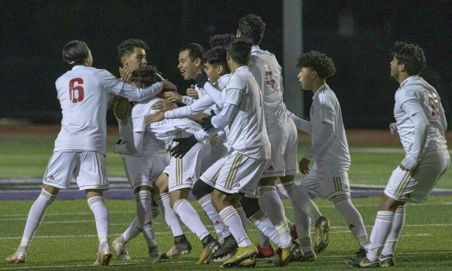 Caney Creek teammates surround Caney Creek junior Antonio Palacios after he scored during a District 20-5A boys soccer match at Berton A. Yates Stadium in Willis. Photo: Cody Bahn, Houston Chronicle / Staff Photographer / © 2018 Houston Chronicle