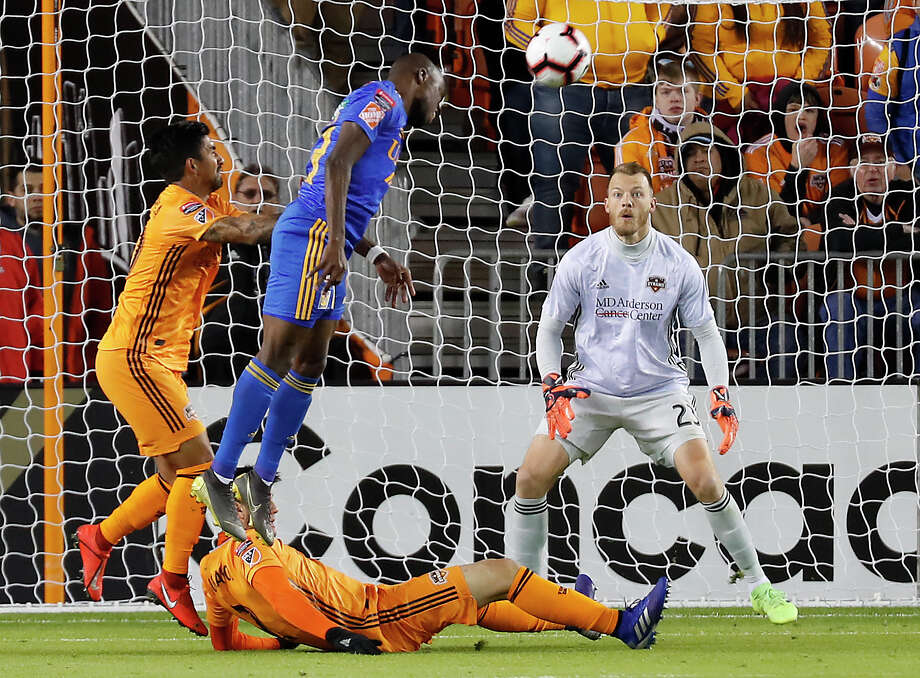 UANL Tigres forward Enner Valencia (13) takes a shot with a header toward Houston Dynamo goalkeeper Joe Willis (23) during the first half of the CONCACAF Champions League quarterfinal at BBVA Compass Stadium on Tuesday, March 5, 2019, in Houston. Photo: Brett Coomer, Staff Photographer / © 2019 Houston Chronicle