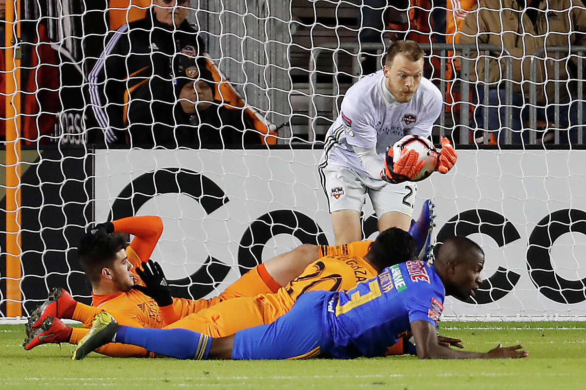 Houston Dynamo goalkeeper Joe Willis (23) saves a shot on goal by UANL Tigres forward Enner Valencia (13) during the first half of the CONCACAF Champions League quarterfinal at BBVA Compass Stadium on Tuesday, March 5, 2019, in Houston.