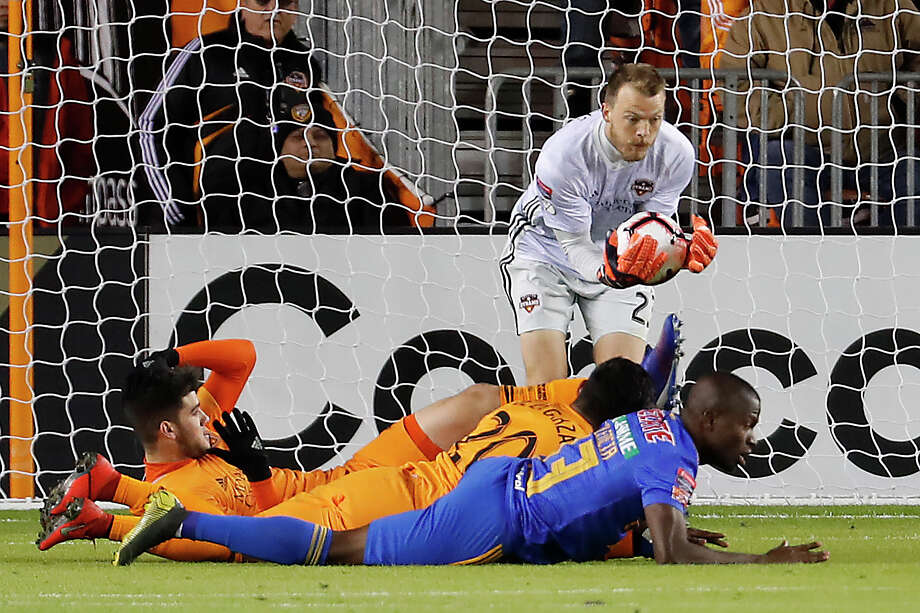 Houston Dynamo goalkeeper Joe Willis (23) saves a shot on goal by UANL Tigres forward Enner Valencia (13) during the first half of the CONCACAF Champions League quarterfinal at BBVA Compass Stadium on Tuesday, March 5, 2019, in Houston. Photo: Brett Coomer, Staff Photographer / © 2019 Houston Chronicle
