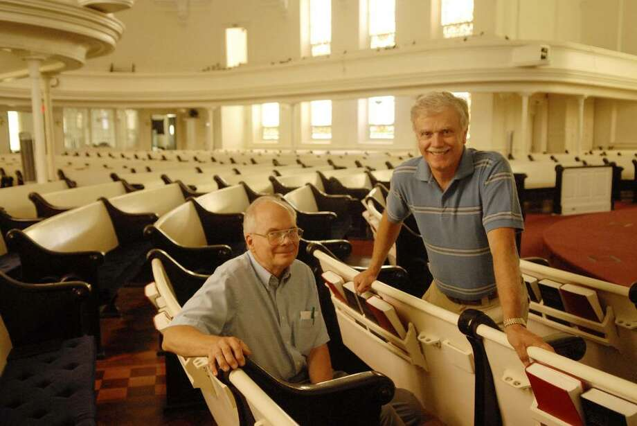 Jim Stewart, left, an elder, and Dave Vincent, right, a deacon at First Presbyterian Church of Schenectady, pose inside the church in Schenectady on Tuesday. The two men have written a book about the church.  The congregation is celebrating its 250th anniversary.  (Paul Buckowski / Times Union) Photo: PAUL BUCKOWSKI / 00009557A