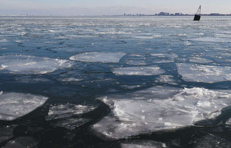 Ice floats on the Lake Michigan are seen at Navy Pier in Chicago. Cold is expected to give way later this week to another round of snow. Photo: Nam Y. Huh | AP