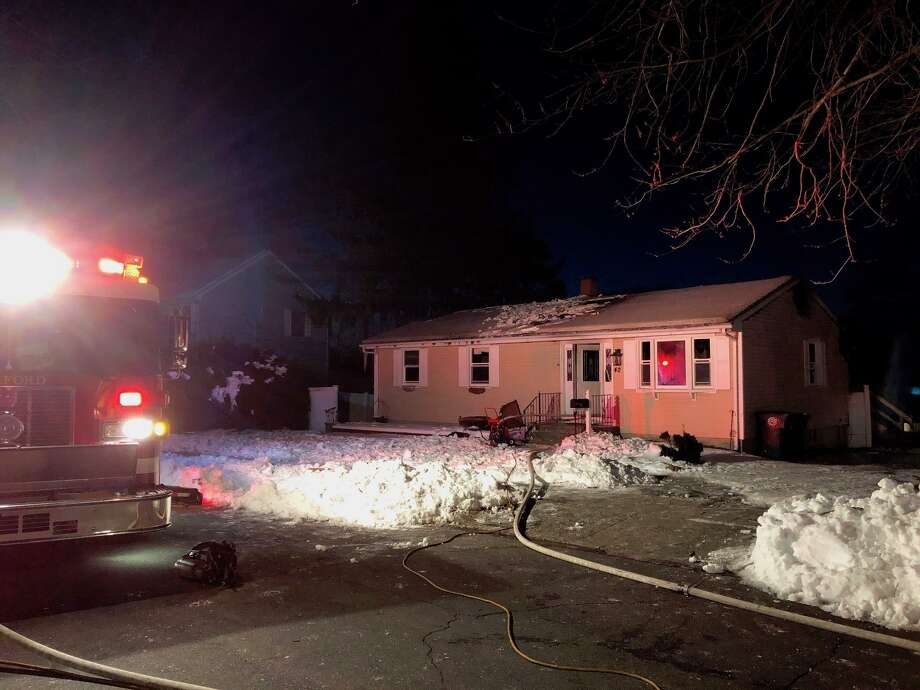 A fire severely damaged a newly purchased home at 42 Windsong Lane in Milford early on Wednesday, March 6, 2019. Photo: Milford Fire Dept.