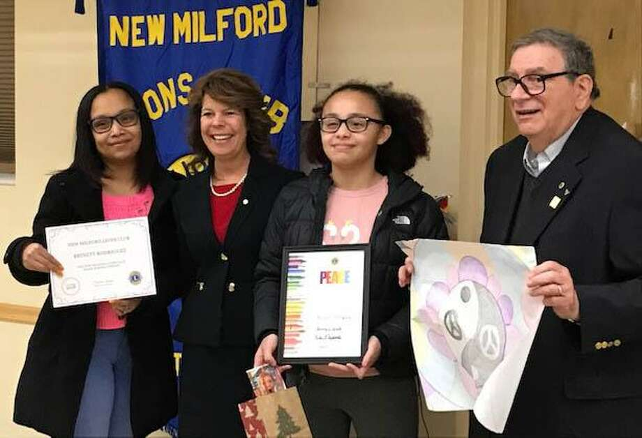 The New Milford Lions Club recently recognized Brinett Rodriguez as the local winner of the Lions International Peace Poster Contest. Brinett, second from right, is shown above with, from left to right, her mother Nathaly, Lions President Tammy Deak and Lion Bob Coppola. Photo: Courtesy Of Rotary Club Of New Milford / The News-Times Contributed