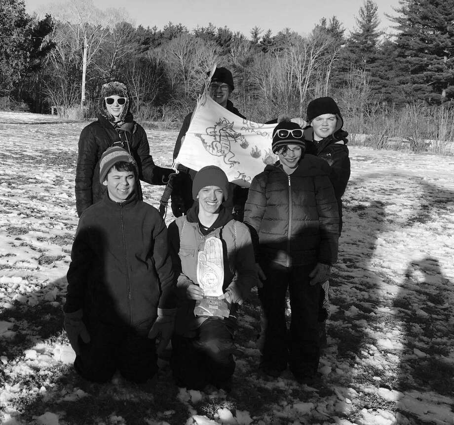 New Milford Boy Scout Troop 31 recently competed in the Northwest Hills District Klondike Derby. The event, held at White Memorial in Litchfield, typically consists of several stations where Scouts test their Scout skills to earn points. One of the troop's patrols, the Red Dragons, won best sled. They are shown above, from left to right, Jacob Czupkowski, Tristen Kayfus and Justin Schomber and, in back, Ben Schipul, Gabe Larsen and Conner Lehmacher. Photo: Courtesy Of Boy Scout Troop 31 / The News-Times Contributed