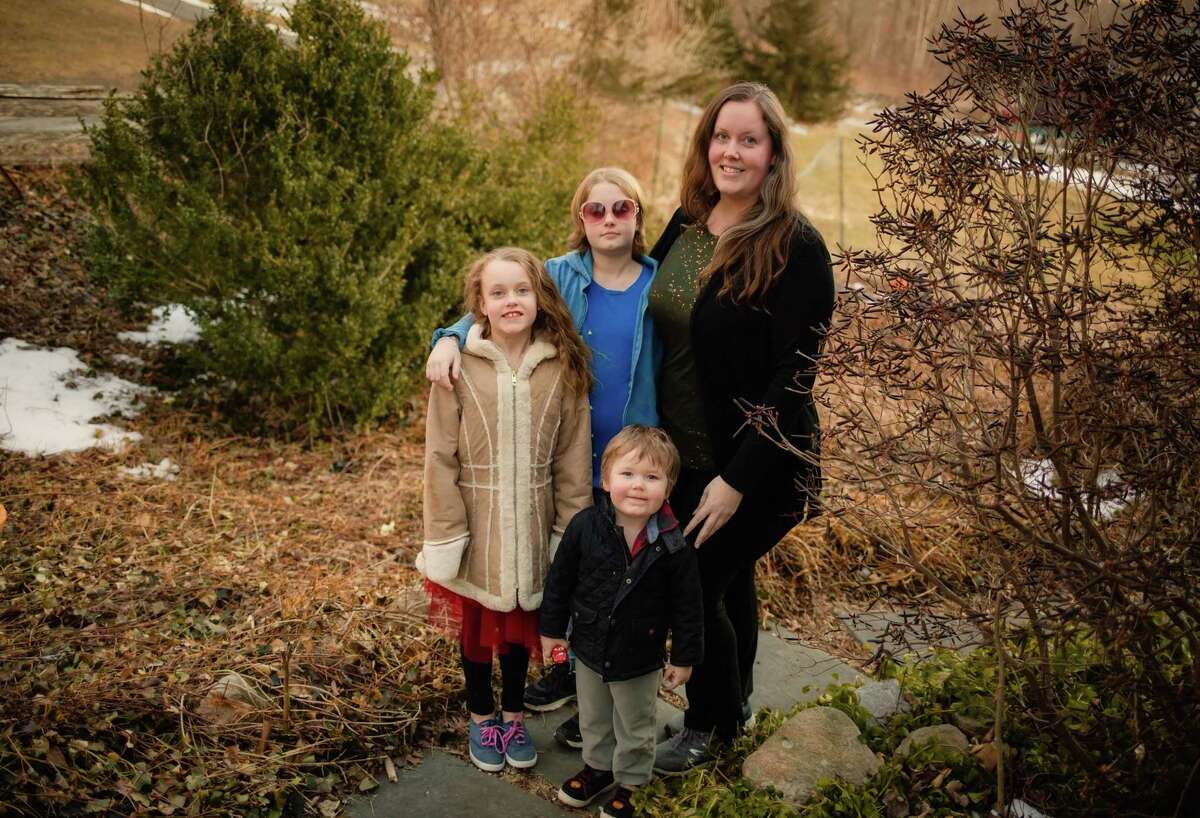 New Milford resident Emily Lee is shown with her children Monica, Evelyn, and JJ - the inspiration behind her app, bWISHd.
