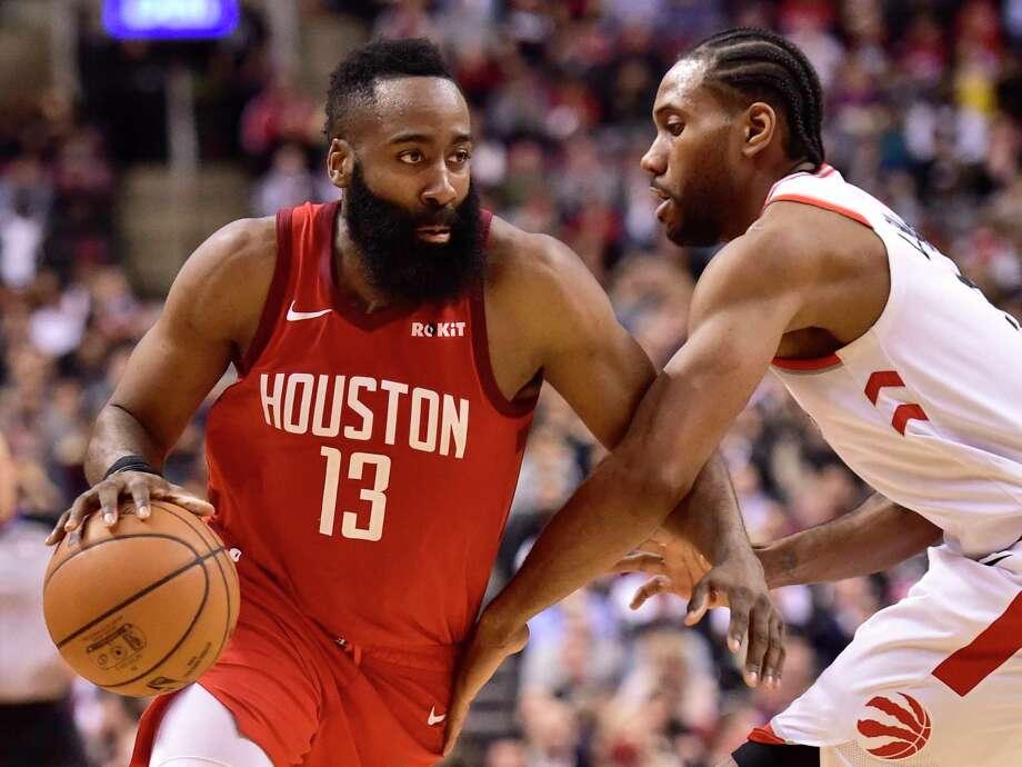 6814063d3e90 Houston Rockets guard James Harden (13) controls the ball as Toronto  Raptors forward Kawhi
