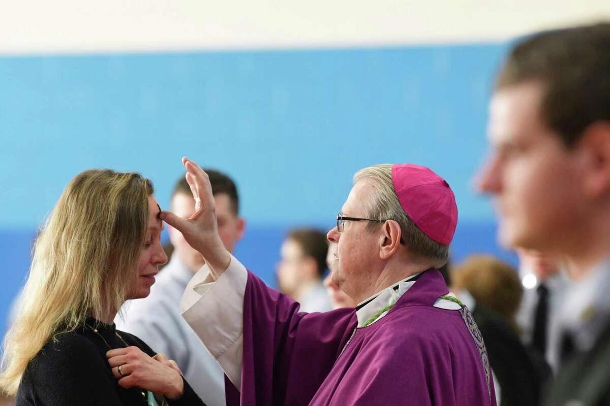 Teacher Valerie Sleight receives ashes from Bishop Edward Scharfenberger during Ash Wednesday mass at La Salle Institute on Wednesday, March 6, 2019, in Troy, N.Y. (Paul Buckowski/Times Union)
