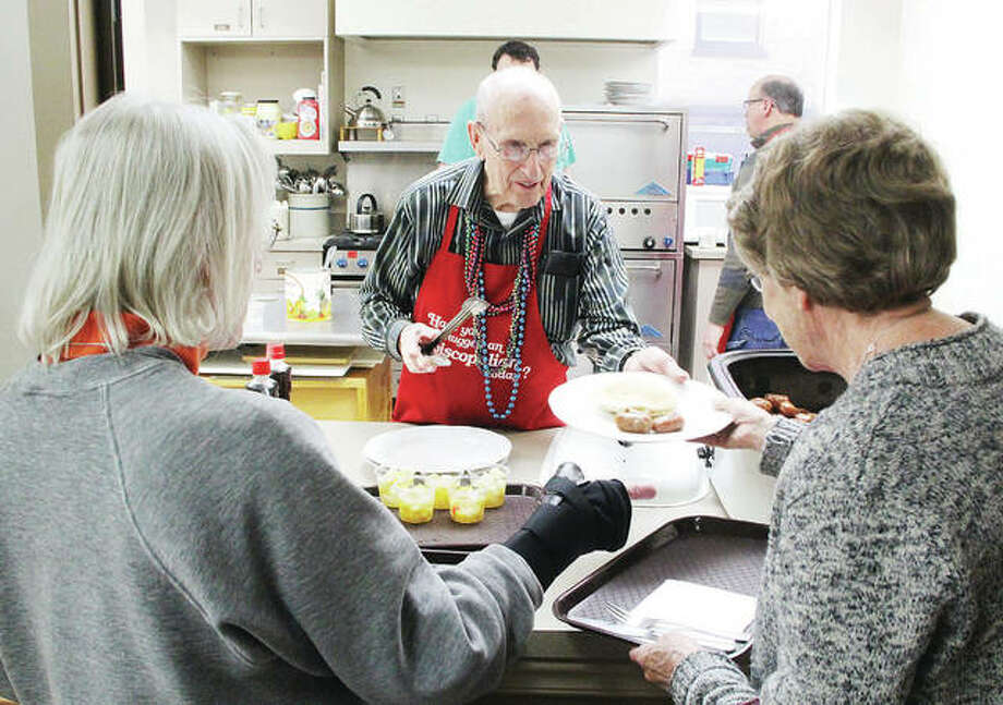 Richard Napp, a member of the Episcopal Christian Mens Club at St. Paul Episcopal Church in Alton, dishes out pancakes and sausage during the annual Shrove Tuesday Pancake and Sausage Supper at St. Paul Episcopal Church in Alton. Historically Shrove Tuesday was a way to use up rich foods in anticipation of Lenten fasting. Photo: Scott Cousins | The Telegraph