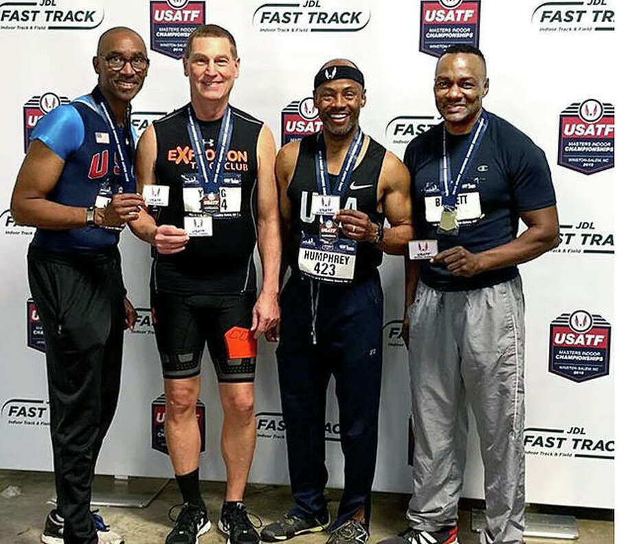 Wood River's Mike Young, second from left, and the other members of the 4x200 relay men's 55-59 USATF Masters National Champions after receiving their gold medals at the Masters USATF National Championships in Winston-Salem, North Carolina. From left: Michael D. Jones, Young, Ronald Humphrey and Owen Barrett. Photo: Submitted Photo