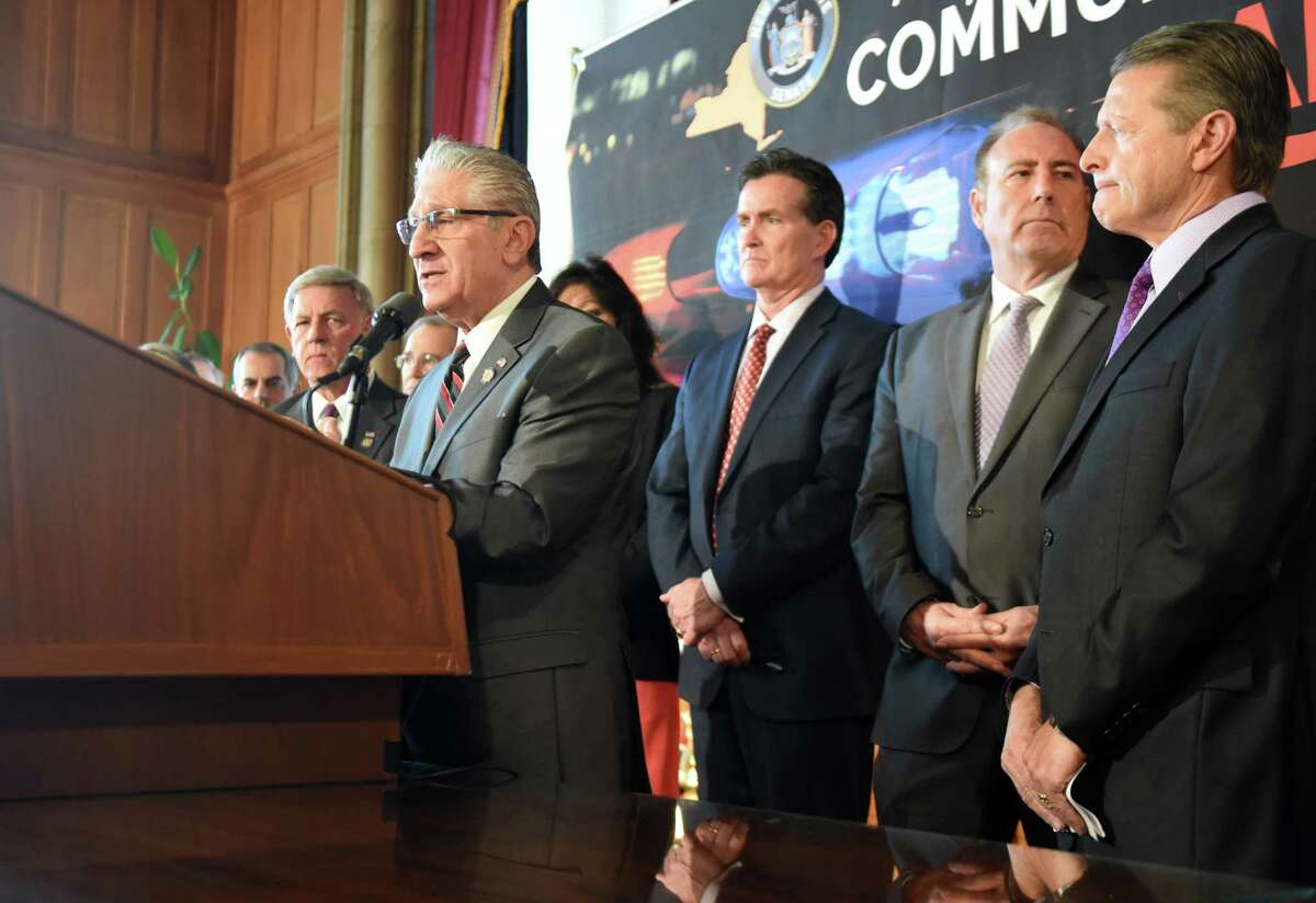Sen. James Tedisco, left, speaks during a press conference where he addressed the downside of proposed criminal justice reform measures on Wednesday, March 6, 2019, at the Capitol in Albany, N.Y. (Will Waldron/Times Union)