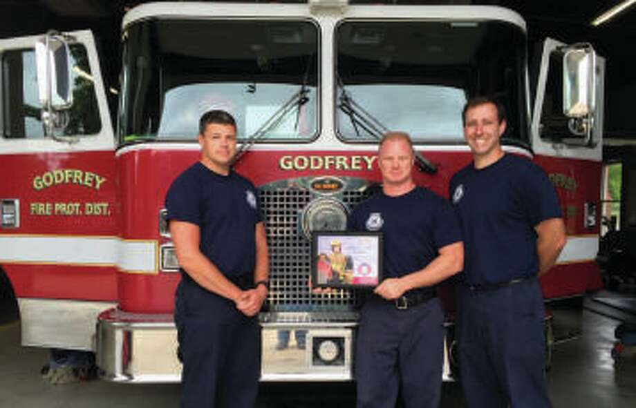 Godfrey Fire Capt. Jake Ringering, left, with firefighters Chris Dennison and John Farmer. Ringering died Tuesday after a brick structure collapsed on him and others during a fire in Bethalto. Photo: For The Intelligencer