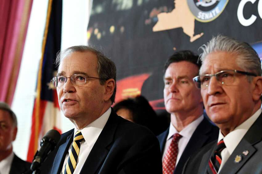 Schenectady County District Attorney Robert Carney, left, is joined by Senate Republican Leader John Flanagan, center, and Sen. James Tedisco, right, during a press conference where they addressed the downside of proposed criminal justice reform measures on Wednesday, March 6, 2019, at the Capitol in Albany, N.Y. (Will Waldron/Times Union)
